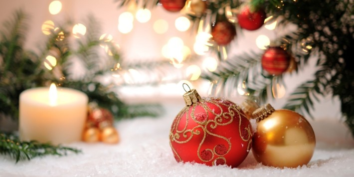 Candle with christmas balls and pine tree