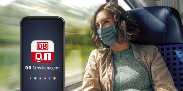 Frau mit Mundschutz in Regionalzug