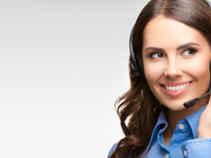 cheerful customer support phone operator in headset