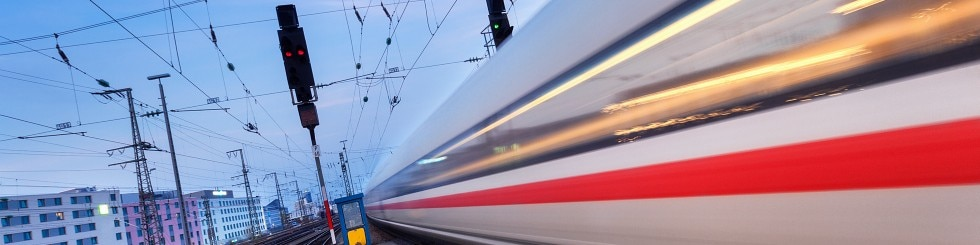 High speed passenger train on railroad track in motion
