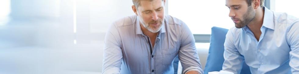 Mature businessman using a digital tablet