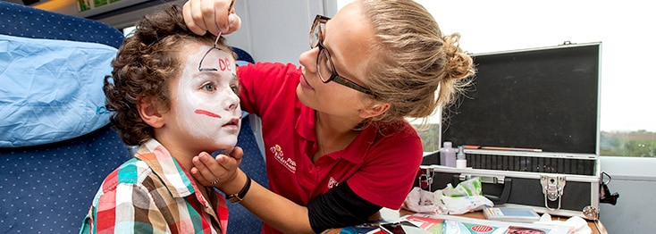 Caregiver painting a child's face